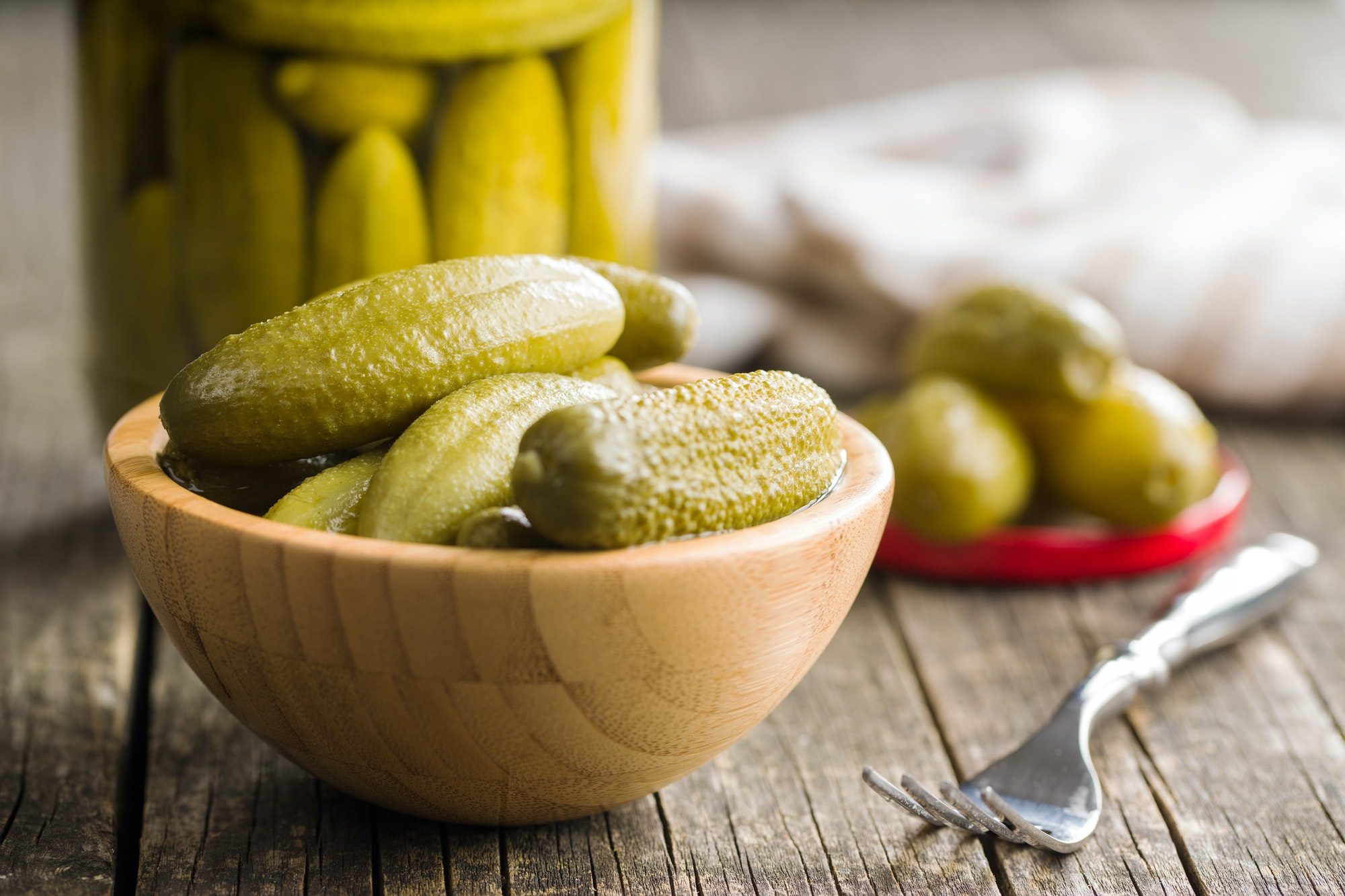 Pickles in bowl. Preserved cucumbers.