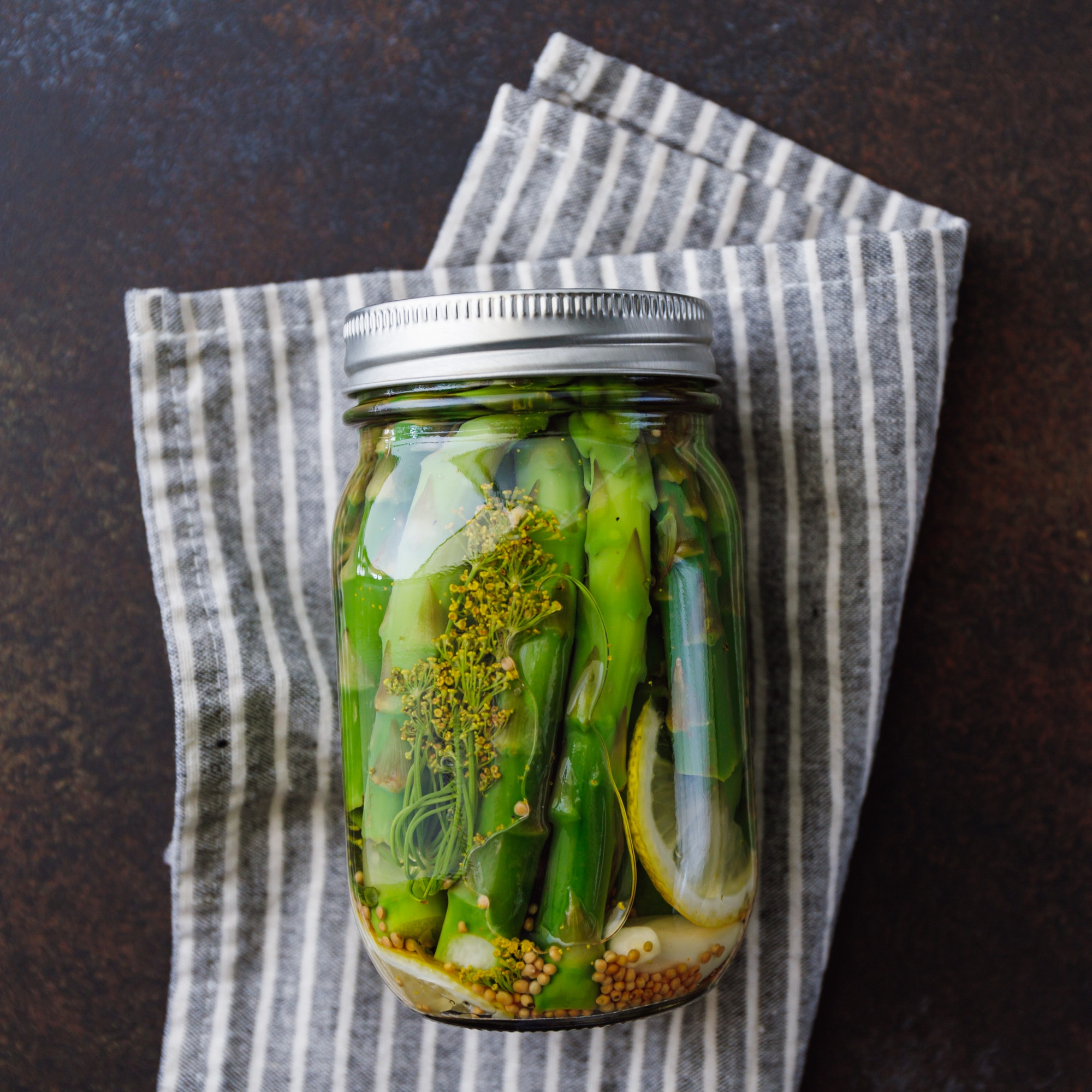 Top view of pickled asparagus in a ja